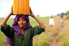 Walking with water near Arekober, Ethiopia.