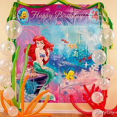 Make an underwater wonderland with balloons and streamers - it's easy! Click the pic for more Little Mermaid party ideas you just gotta *sea*!