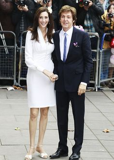 """Celebrity Wedding Photos! - Paul McCartney and Nancy ShPaul McCartney and Nancy Shevell: October 9, 2011   Paul McCartney said """"I do"""" to Nancy Shevell during an afternoon ceremony in London. Shevell wore a knee-length ivory dress by her new stepdaughter Stella McCartney, who also designed her father's navy suit. evell: October 9, 2011."""