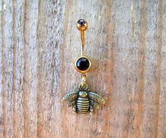 Bumble Bee Belly Button Ring,Gold Navel Ring, Dangle Belly Ring, Body Piercing, Bee Charm, Body Jewelry, 14g Barbell. by TheCharmedBelly on Etsy https://www.etsy.com/listing/266620263/bumble-bee-belly-button-ringgold-navel