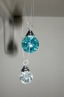 Bake marbles at 325/350 for 20 min. Put in ice water to make them crack on the inside. Glue end caps to them with starter rings to create pretty tiny ornaments.