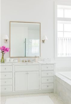 House Tour: Blue Crush - Design Chic - beautiful bathroom - love the white with a pop of color from the flower arrangement!