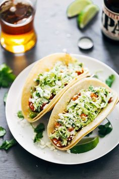 Spicy Shrimp Tacos with Garlic Cilantro Lime Slaw - ready in 30 minutes and loaded with avocado, spicy shrimp, and a homemade creamy lime slaw. MADE: used Greek yogurt instead of sour cream for the slaw. Healthy Taco Recipes, Healthy Meals For One, Healthy Tacos, Fish Recipes, Seafood Recipes, Mexican Food Recipes, Easy Meals, Cooking Recipes, Eat Healthy