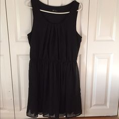 Little Black Dress Chiffon dress that comes to about mid thigh. It can be dressed up or down. It has two belt hoops, one on each side. I wore it once for homecoming and styled it with an edgy belt. From Macy's! Dresses