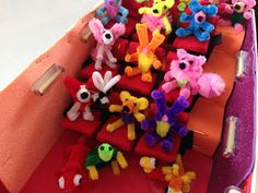 pipe cleaner animals at a shoebox movie theater