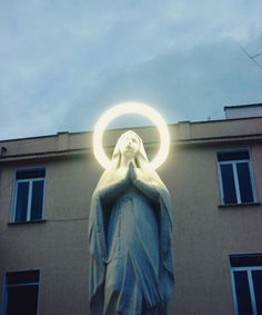 "allaboutmary: ""A Madonna with neon halo in Naples, Italy. """
