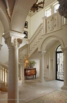 Traditional Entryway with Crown molding, Columns, Transom window, French doors, Loft, specialty door, Arched window