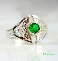 Bailey Triskele ring in silver with a 5mm emerald. Celtic design by J. Bellchamber