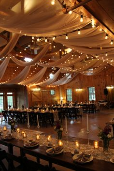 Fabrics and lights beautifully strung by Rain or Shine. Staging by @morethanamoment in our #weddingbarn the Celebration Barn #vermontweddings