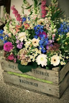 Cheerful flowers in a vintage style crate from Becci Hobbs of 'Bijoux' www.bijouxfloral.co.uk