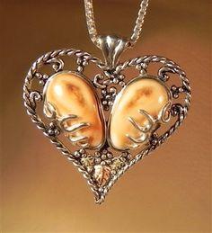 custom elk ivory jewelry makers   pair of beautiful elk ivory set in sterling silver by Ildiko Wagoner ...