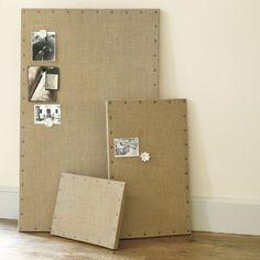 Cork board, burlap, upholstery tacks.