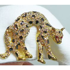 1980's Leopard Brooch Rhinestones Enamel Black Gold Red Eyes (£16) ❤ liked on Polyvore featuring jewelry, brooches, gold jewellery, red jewelry, 80s jewelry, gold rhinestone brooch and gold jewelry