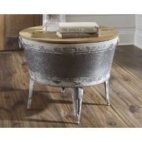 The classic galvanized metal tub—with a new sense of purpose. Sporting a split lift wood top that allows for handy storage, the Shellmond round coffee table is sure to add a uniquely charming touch to your modern farmhouse. Table, Farmhouse Style Furniture, At Home Store, Furniture, Metal Tub, Ashley Furniture Homestore, Home Furniture, Coffee Table With Storage, Coffee Table