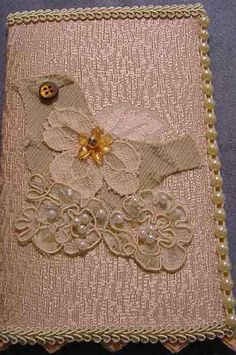 Handmade textured bird, lace wing, button eye, wedding dress cutouts and pearls, pretty trim. Friendship collage inside.