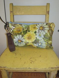 made from a painting on canvas with recycled leather and leather belt handle