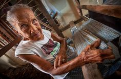 A woman working on her wooden weaving loom in the countryside of Bhutan. (Andrew Eio/Getty Images)....39 Stunning Images Of Women At Work All Over The World