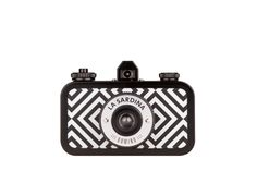 "la sardina.    effortlessly classy and stylish in its monochromatic diamond pattern, la sardina domino ""pattern edition"" boasts multiple-exposure capabilities and a smooth-scrolling rewind dial.  it's exceptionally talented in producing gorgeous photos."