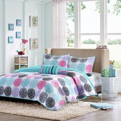 Teal, Aqua, Purple, Pink and  Black doodled circles complete this coverlet.  The reverse  side features white polka dots on an aqua background.   Finish off this awesome set with a striped decorative  throw pillow.