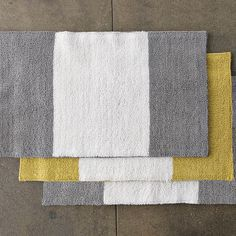 could be good for two bath mats in front of the sinks in the grey - though maybe in the yellow to mix it up then we could bring some yellow in else where - maybe too many stripes might just need natural
