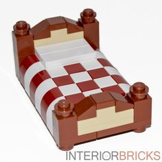 Give your minifigures a good night's rest with this incredible custom bed set. Terrific design with two tone head and foot boards as well as elegantly checkered bedding in dark red and white.