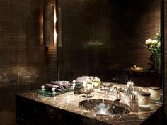 Gorgeous powder room in Casa Forma's latest project in One Hyde Park.Love the tiles and the hammered sink