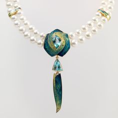 http://www.fredrichenameldesign.com/aquamarine-and-pearl-necklace-with-pearl-drops/