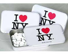 CitySouvenirs.com - I Love NY Mints, $3.99 (http://www.citysouvenirs.com/i-love-ny-mints/)I Love New York Tin  With this tin of sugarless peppermints, you can have fresh breath in a New York Mint. NYC Candy Tins come with about 70 round peppermint candies and feature the classic I Heart NY logo on the front.  With its sliding cover, the New York City collector's candy tin is perfect for reuse.
