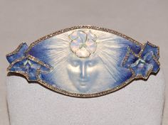 René Lalique. 1900 signed 'La Pensee' Brooch. A pale blue and gold enamel oval…