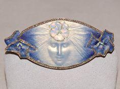 René Lalique. 1900 signed 'La Pensee' Brooch. A pale blue and gold enamel oval…