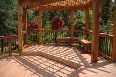 Large multi-level deck with pergola and wooden bench