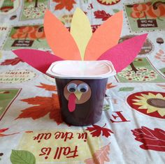 """November 5 Preschool Snacks - Inspired by another idea found on Pinterest. Pudding cups decorated like turkeys. Could use jello cups for those that can't have milk. Could write """"Happy Thanksgiving"""" on the white tear-off lid also."""