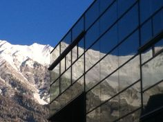 The mirroring mountains of the (Northern Range) of in modern architecture. (University of Business Sciences Innsbruck) Innsbruck, Alps, Modern Architecture, Tourism, Louvre, Range, Mountains, City, Business