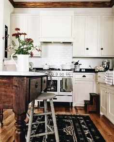 love the rich darker wood tones with the white cabinets and tile backsplash