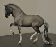 Another beautiful custom model horse, this one crafted from a Breyer body (CM Totilas Breyer by Tammy Myrold).