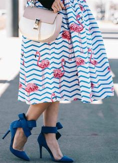 What's more fun than flamingo dancing atop stripes? Flamboyantly Flamingo Printed Midi Skirt (item number: B20160618005) featured by withlovelilyrose Blog