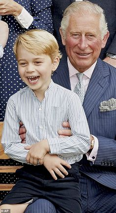 Prince Charles' birthday photo - Prince George sat happily on his grandfather's knee breaking into a toothy laugh in one frame