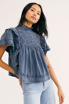 Presented by Free People. In 2 colors. Victorian-inspired top featured in a worn chambray fabrication with pleating at chest and ruffled sleeves, designed with ladder lace inserts and keyhole closure at back. Over 50 Womens Fashion, Fashion Over 50, Boho Tops, Lace Tops, Free People Clothing, Women's Clothing, Free People Store, Denim Top, Denim Shirts