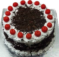 Black Forest Cake eggless chocolate sponge cake whipped cream and cherries layered alternatively.. No Condensed Milk or Curds Used This time I used buttermilk milk vinegar as a egg
