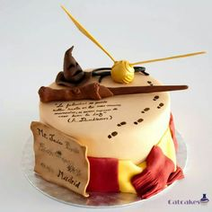 Harry Potter birthday cake so cool has the marauders map, golden snitch, wand, scarf, the sorting hat ....Everything!