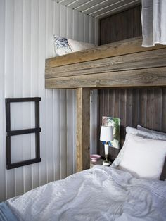 A Cozy Icelandic Cottage | Design*Sponge ladder on wall detail