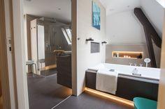 Een badkamer in een ruimte met een schuin dak? Bij Baderie is alles mogelijk.