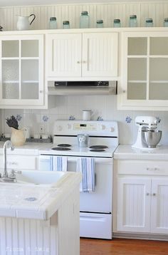 A bright, cheery kitchen with a big stove, tile backsplash, lots of cabinets, a mixer for our baking, an island for prepping and eating brunch.