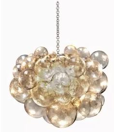 Have you looked at the chandeliers at the Menlo Park Ruby Livingdesign? Their designer chandeliers are unique, stylish, and add can add dazzle to every home! Whether you are looking for a Venetian blown glass piece like this one, or a mid-century modern inspired piece, all the best chandeliers are at Ruby Living.