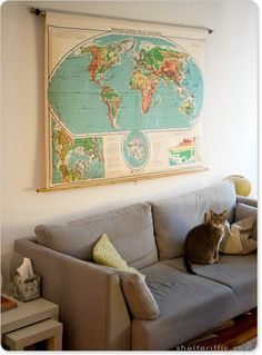 I love the map idea and one pinner on this picture suggested putting the map on a working roller blind because the map mechanisim is so hard to roll up and down without major catastrophe.  I like that idea.  Wish my map was more of these colors. ~kss