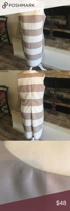 """Calvin Klein striped dress Taupe and off white striped, fully lined, zips in the back, 20"""" armpit to armpit, 38"""" shoulder to bottom, poly/spandex blend, tiny hole in dress from store security tag. Please see pic. Calvin Klein Dresses Midi"""