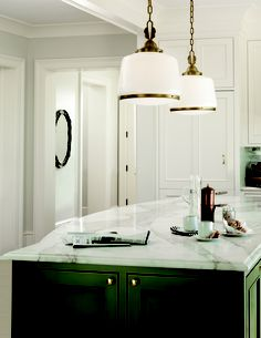A pair of our deco drum shades light a kitchen island.