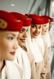 Flawless skin and bright red lips (and a matching hat!) via Emirates Airline attendants uniform. LOVE!