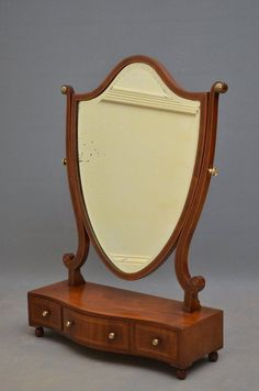 Fine quality Edwardian, mahogany dressing table mirror with original shield shaped mirror in string inlaid frame on shaped supports, serpentine base with 3 drawers and ball feet, all in excellent condition throughout - ready to place at home. Vintage Dressing Tables, Dressing Table Mirror, Makeup Storage Trays, Long Mirror, Wooden Console, Standing Mirror, Vintage Bathrooms, Home Decor Furniture, Furniture Design