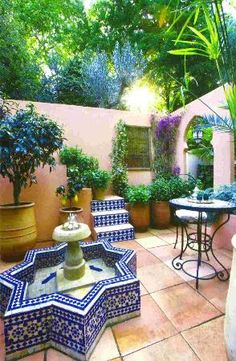 Moroccan style courtyard garden with tiled water feature.